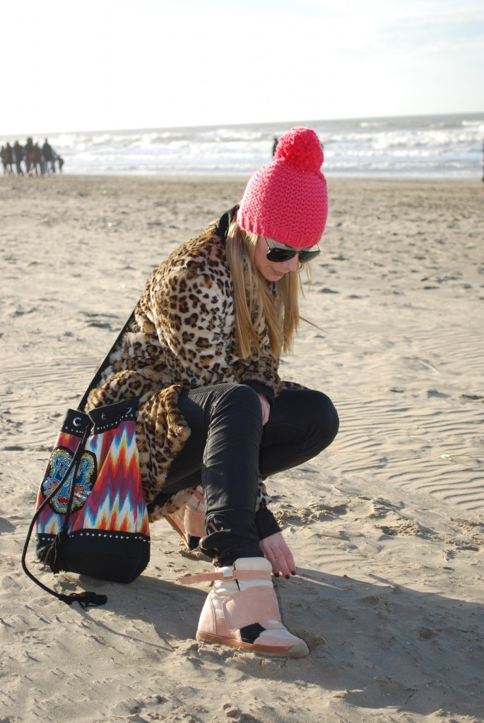 leopard coat red beanie batik bag sneakers beach