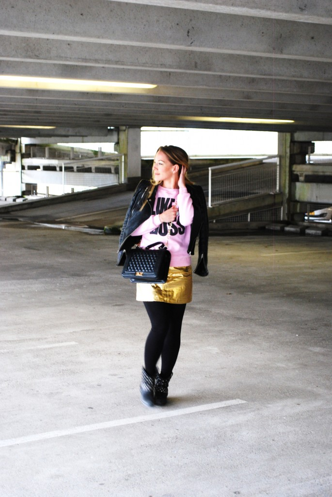 golden skirt pink sweater boy bag leather jacket